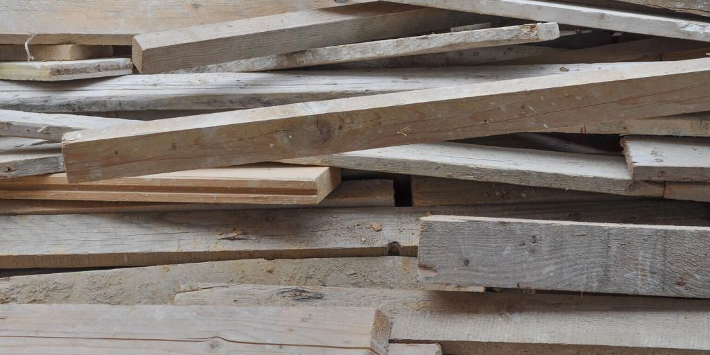 assorted aged scrap wood in a pile