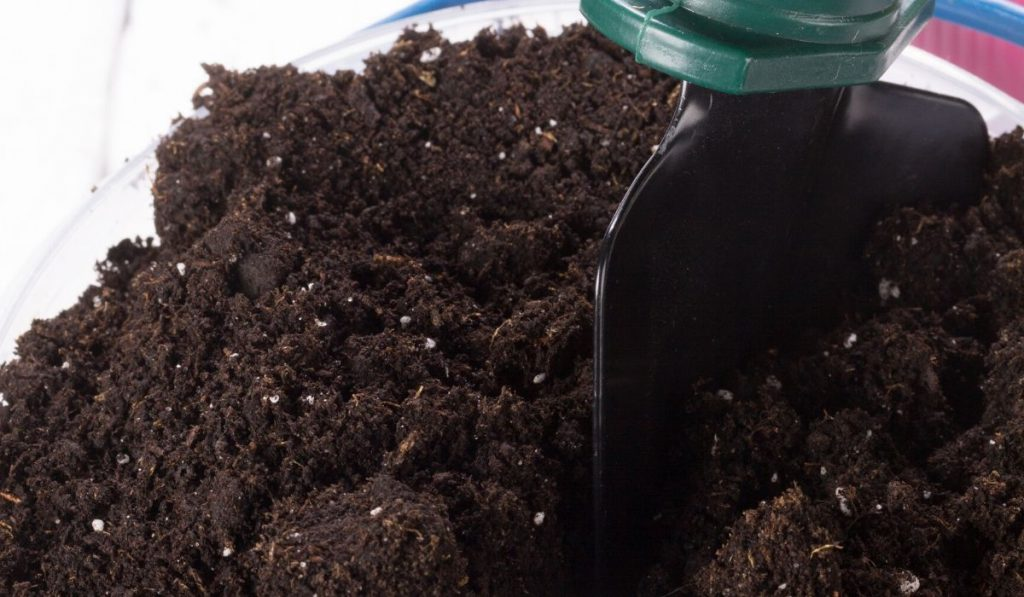 potting soil with spade