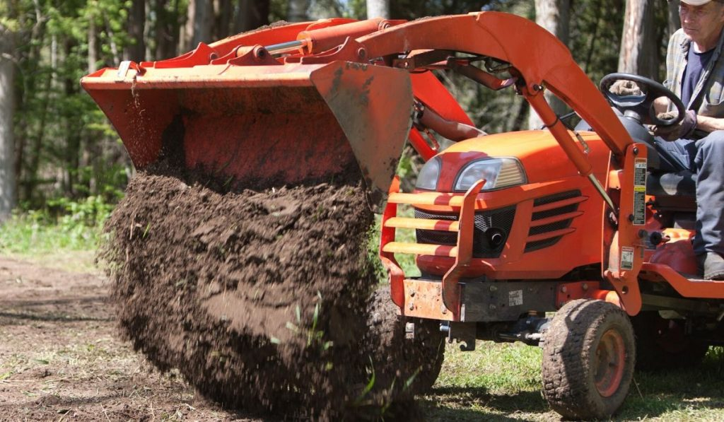 Tractor dumping topsoil