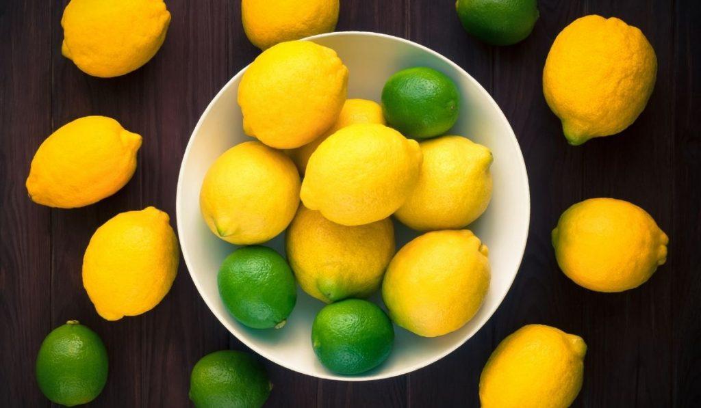 limes and lemons inside bowl