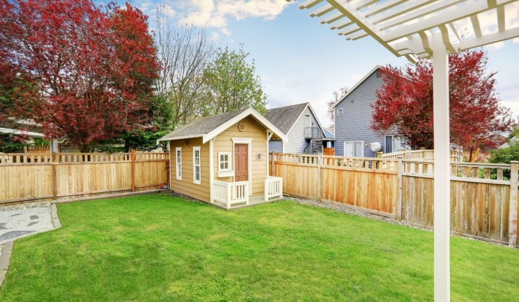 small wooden shed in a backyard