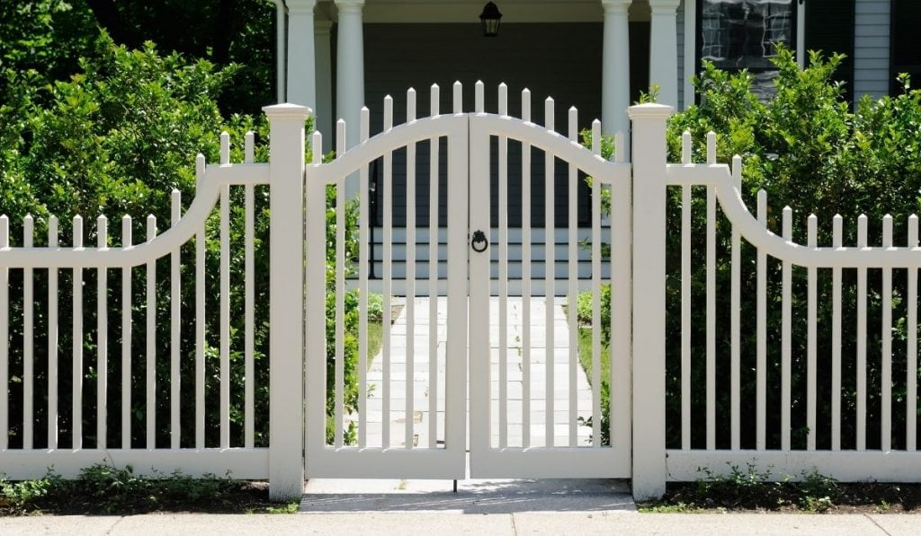 white fence to add security to your home