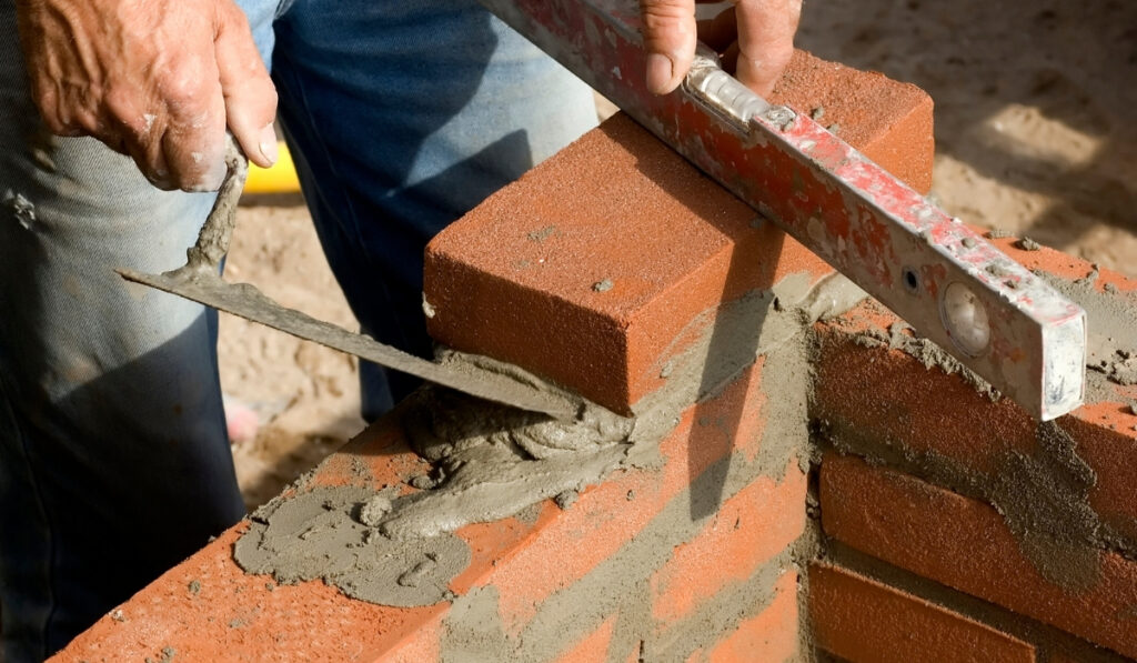 brick layer with tools and mortar