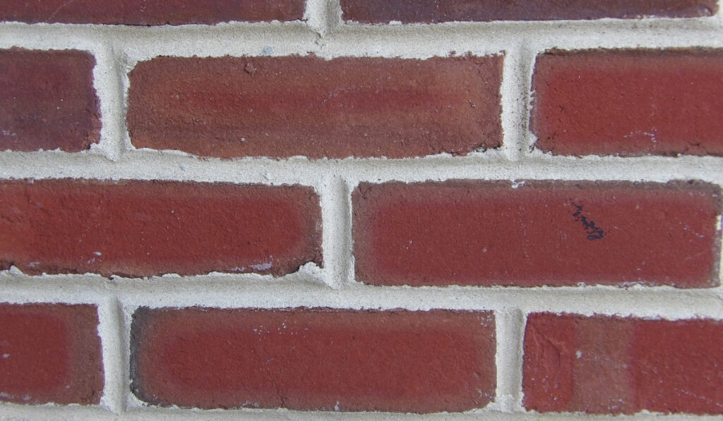 bricks with spaces filled with mortar