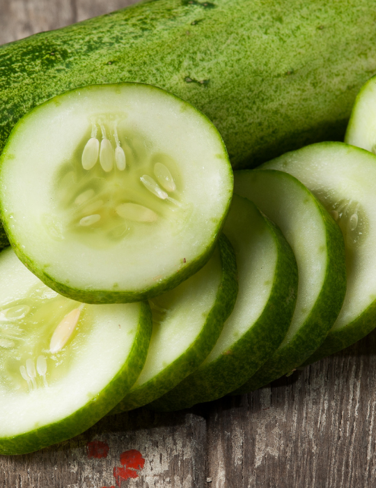 whole and sliced cucumber on the table
