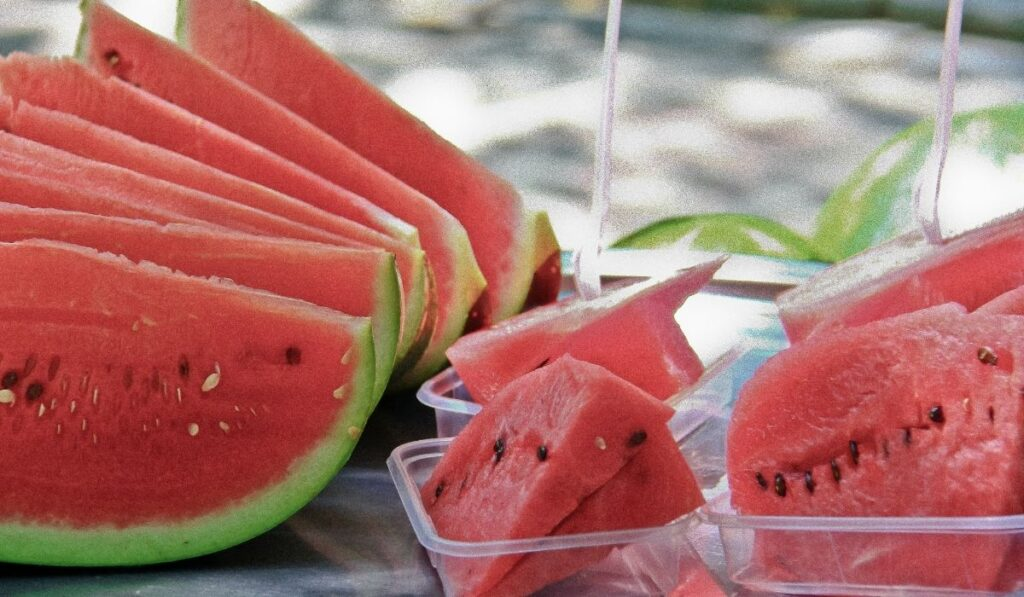 sliced watermelons and some in small containers